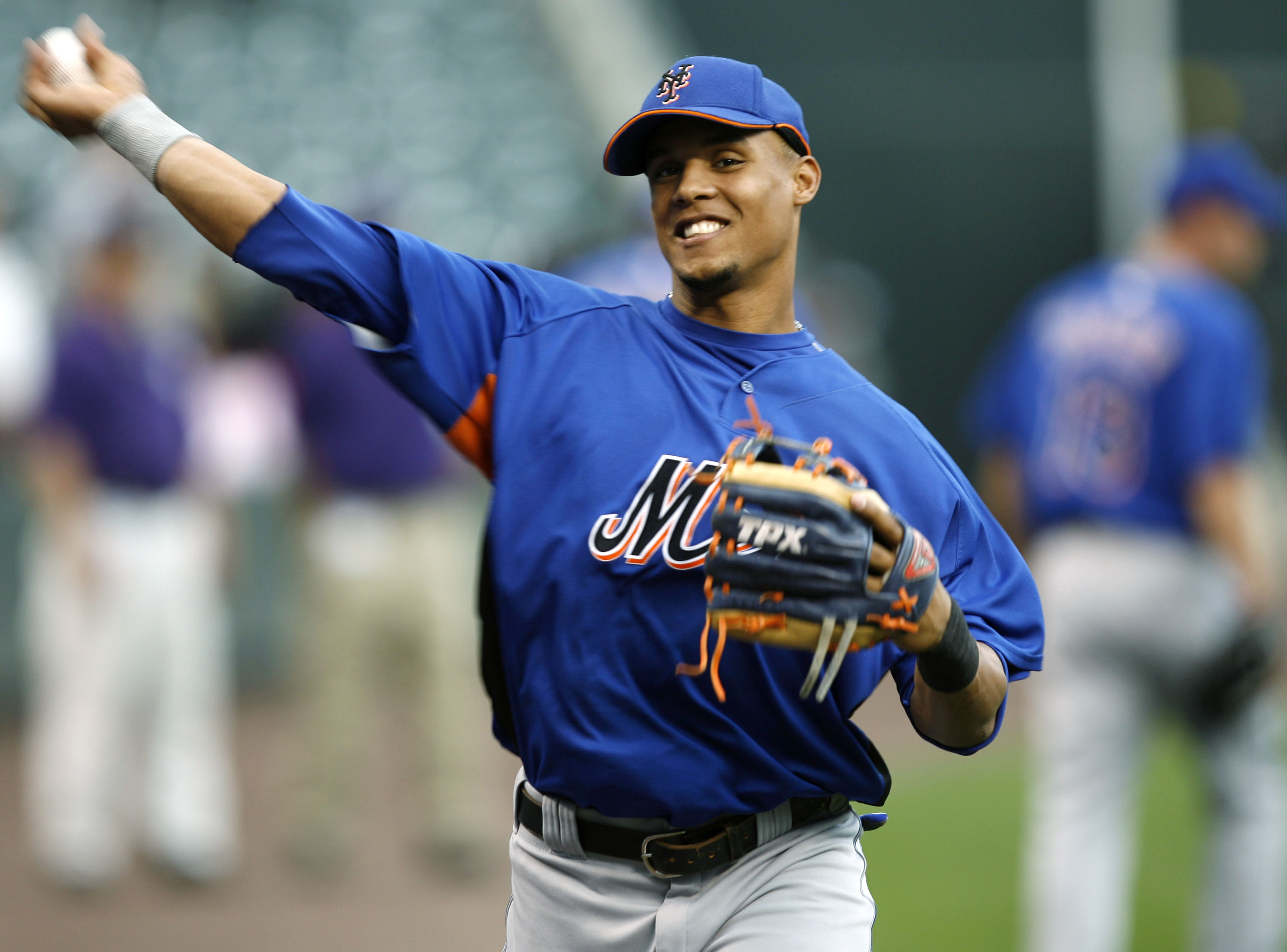 New York Mets left fielder Carlos Gomez throws the ball during the team's batting practice before playing the Colorado Rockies in a Major League Baseball game in Denver on Tuesday, July 3, 2007. (AP Photo/David Zalubowski)