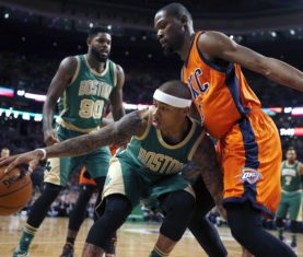 Oklahoma City Thunder's Kevin Durant, right, defends against Boston Celtics' Isaiah Thomas, center, during the first quarter of an NBA basketball game in Boston, Wednesday, March 16, 2016. (AP Photo/Michael Dwyer)