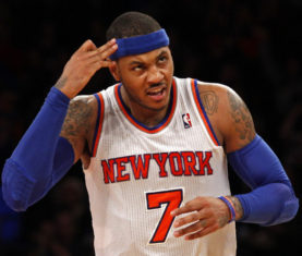 New York Knicks forward Carmelo Anthony reacts after hitting a three-point shot against the New Orleans Hornets in the second quarter of their NBA basketball game at Madison Square Garden in New York, January 13, 2013.    REUTERS/Adam Hunger  (UNITED STATES - Tags: SPORT BASKETBALL)