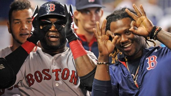 Aug 12, 2015; Miami, FL, USA; Boston Red Sox first baseman David Ortiz (left) celebrates with left fielder Hanley Ramirez (right) after Ortiz hit  a solo home run during the second inning against the Miami Marlins at Marlins Park. Mandatory Credit: Steve Mitchell-USA TODAY Sports