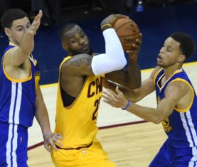 Cleveland Cavaliers LeBron James is defended by Golden State Warriors Stephen Curry (R) and Klay Thompson during Game 4 of the 2015 NBA Finals on June 11, 2015 at the Quicken Loans Arena in Cleveland, Ohio. AFP PHOTO  / TIMOTHY A. CLARY        (Photo credit should read TIMOTHY A. CLARY/AFP/Getty Images)