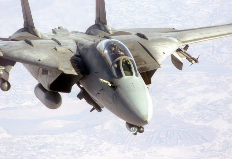 A Navy F-14 Tomcat flies up with its refueling probe out preparing to connect with a tanker. The F-14 is armed with two AIM 9 Sidewinder missiles, a Paveway II Laser Guided GBU-10 2,000-pound bomb, and LANTIRN Pod, as it prepares for a bombing mission over Afghanistan in support of Operation ENDURING FREEDOM. In response to the terrorist attacks on September 11, 2001 at the New York World Trade Center and the Pentagon, President George W. Bush initiated Operation ENDURING FREEDOM in support of the Global War on Terrorism (GWOT), fighting terrorism abroad.