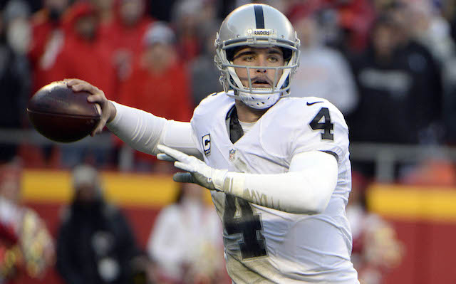Jan 3, 2016; Kansas City, MO, USA; Oakland Raiders quarterback Derek Carr (4) throws a pass against the Kansas City Chiefs in the first half at Arrowhead Stadium. Mandatory Credit: John Rieger-USA TODAY Sports
