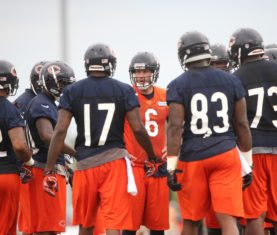 Jul 26, 2013; Bourbonnais, IL, USA; Chicago Bears quarterback Jay Cutler (6) huddles with his teammates during training camp at Olivet Nazarene University. Mandatory Credit: Jerry Lai-USA TODAY Sports