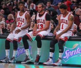 Feb 21, 2015; Chicago, IL, USA; Chicago Bulls guard Jimmy Butler (21), center Joakim Noah (13), and guard Derrick Rose (1) during the second half against the Phoenix Suns at the United Center. The Bulls won 112-107. Mandatory Credit: Dennis Wierzbicki-USA TODAY Sports