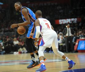 December 21, 2015; Los Angeles, CA, USA; Oklahoma City Thunder forward Kevin Durant (35) controls the ball against Los Angeles Clippers guard Chris Paul (3) during the first half  at Staples Center. Mandatory Credit: Gary A. Vasquez-USA TODAY Sports