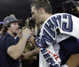 Mark Wahlberg adn Tom Brady (AP Photo/Ben Margot)