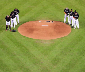 Marlins gather around the pitching mound in honor of Jose Fernandez. (Photo via Marlins)