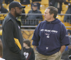 Pittsburgh Steelers head coach Mike Tomlin, left, talks with New England Patriots head coach Bill Belichick as the teams warmup before their NFL football game on Sunday, Oct. 30, 2011, in Pittsburgh. (AP Photo/Gene J. Puskar)
