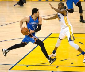 Enes Kanter drives on Andre Iguodala (Kelley L Cox-USA TODAY Sports)