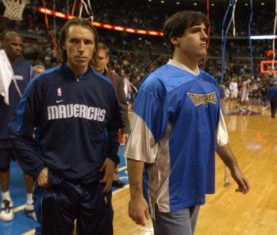 Dallas Mavericks guard Steve Nash, left, and team owner Mark Cuban leave the court after their team lost to the Detroit Pistons, 115-102, Sunday, Jan. 11, 2004, at the Palace in Auburn Hills, Mich. (AP Photo/The Daily Oakland Press, Jose Juarez) ORG XMIT: MIPON101